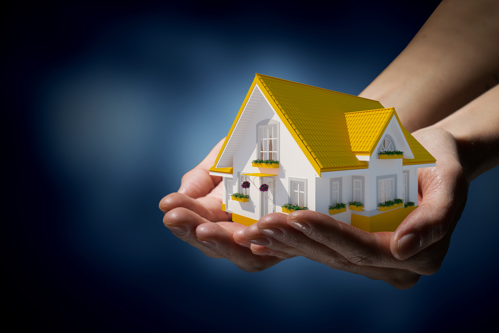 Human hands holding model of dream house-2